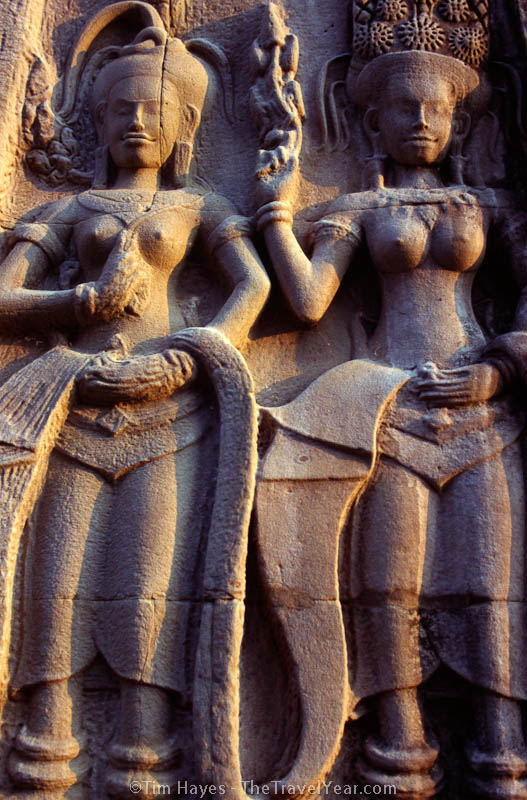 Beautiful carving of two dancing women on the temple walls of Angkor Wat, the most majestic of the many temples in the ancient city of Angkor, Cambodia. This temple was built by the rulers of the Khmer people over eight centuries ago as a dedication to the Hindu god Vishnu.