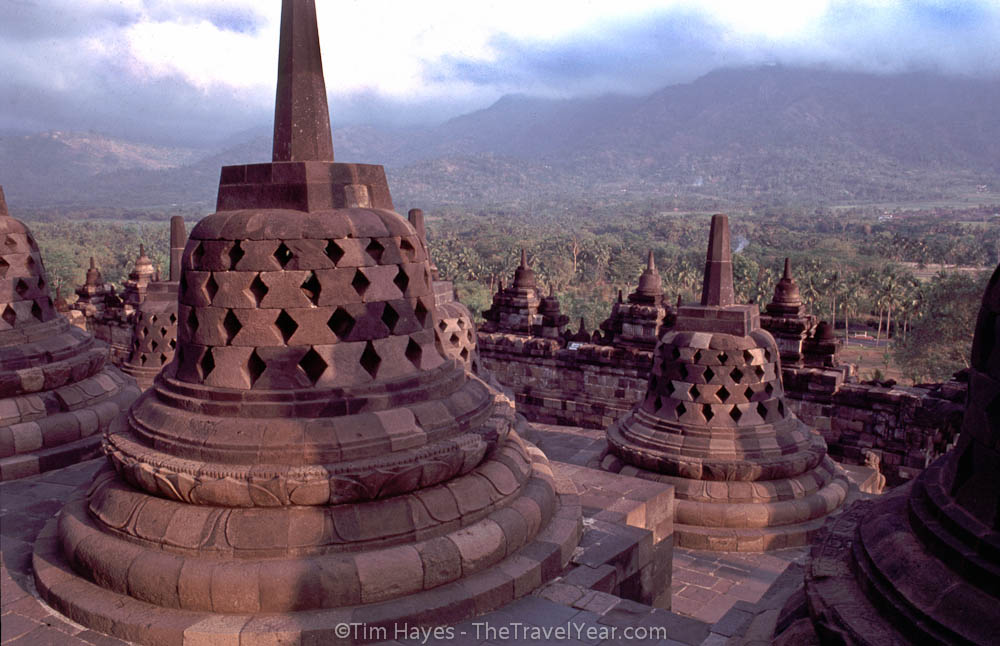 The massive Borobudur Buddhist temple.XXXXBorobudur was built around 800 AD and, with over 1000 carvings depicting Buddhist thought, served as a 60,000 cubic meter stone guide to Buddhism for visiting pilgrims. The temple rises above the Javanese jungle in nine levels. The first six levels contain carved stone panels depicting the cause and effect of abusing sense pleasures; the top three levels represent achieving nirvana through conquering abuse of sense pleasures.