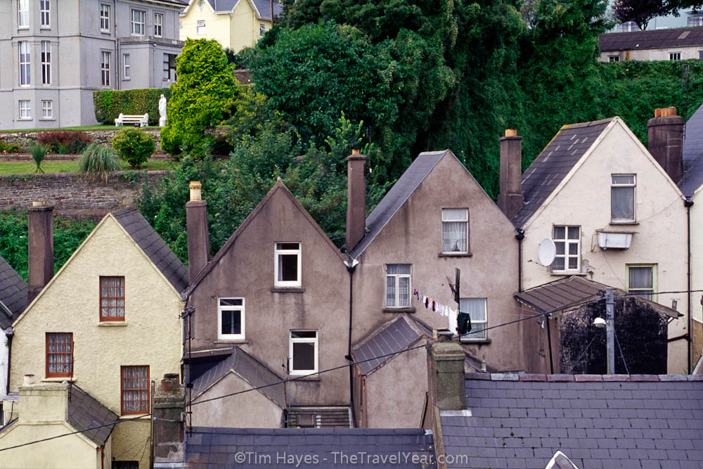 Rowhouses rise up a hill in Cobh, County Cork.