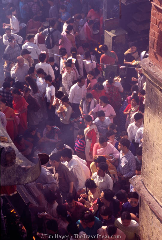 Crowds and incense smoke circle the stupa at Kathmandu's Monkey Temple (Swayambhunath) during Buddha Jayanti, the celebration of Buddha's birthday 2545 years ago.