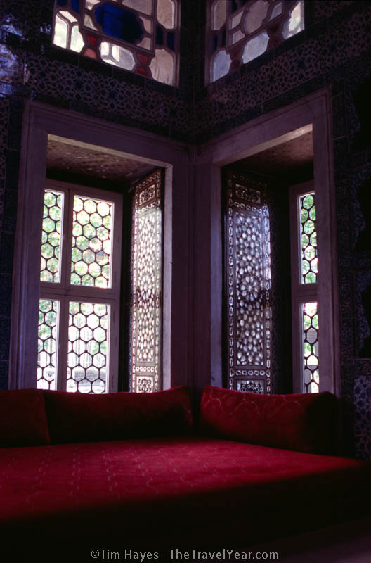 Sun filters across a red couch and mother-of-pearl doors in the Topkapi Palace, Istanbul's home of the sultans.