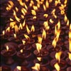 Butter lamps burn on the stairs of Kathmandu's Monkey Temple (Swayambhunath) during Buddha Jayanti, the celebration of Buddha's birthday 2545 years ago.